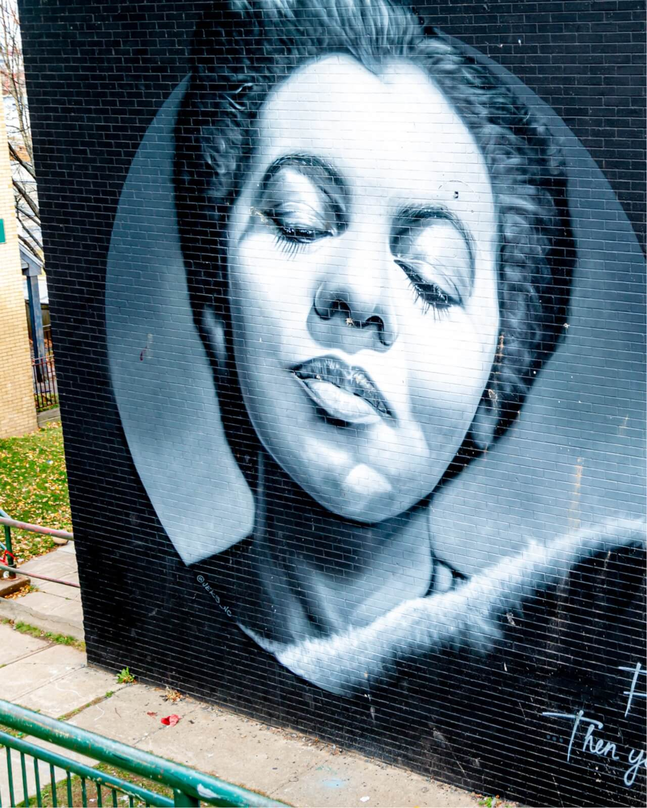 Mural of a lady on the side of a building.